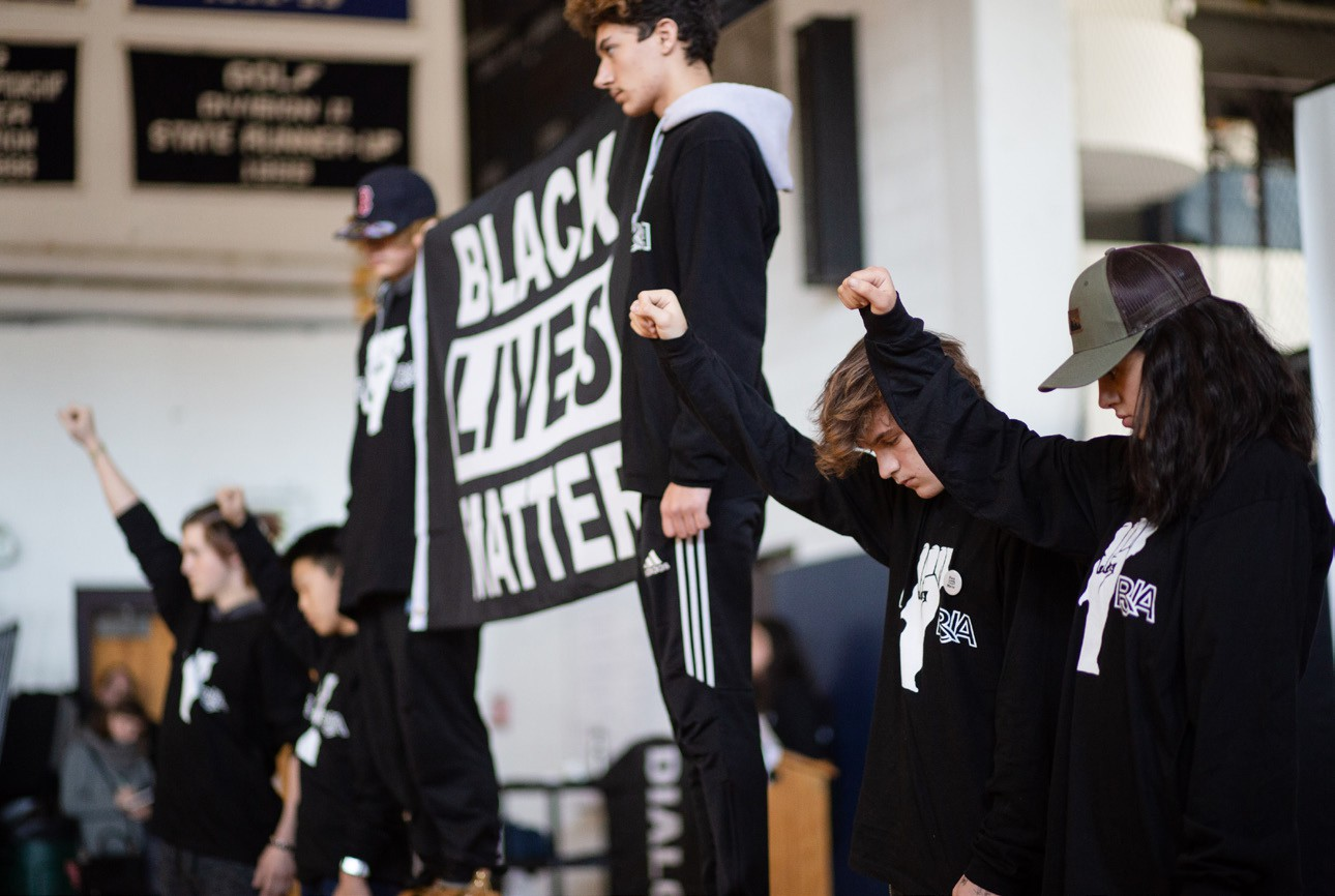 Students at assembly discuss Black Live Matter Flag