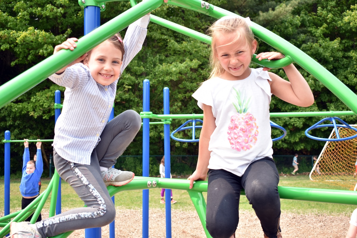elementary students play on the playground